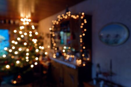 Blurred Background - Illuminated Family Room with Christmas Tree during Christmas Time