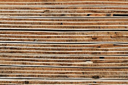 Plywood Background: Weathered Cross Section of Piled Plywood Panels - detail