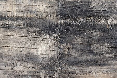 Charred and Weathered Construction Timber Background with Mineral Adherences