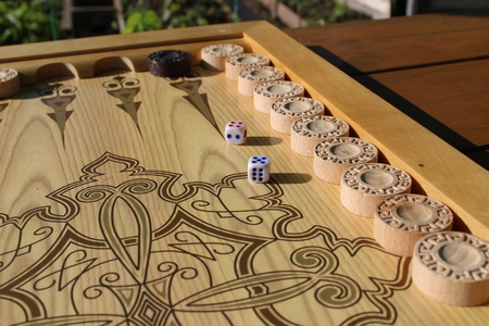 Backgammon is another ancient game, which is great develops of logical thinking skills.
