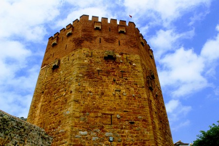 View of the Red Tower from the seafront (Alanya, Turkey). Stock Photo