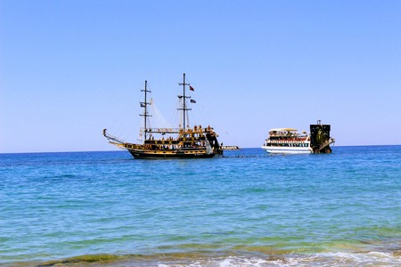 cruising: Pleasure boats cruising along the coast of Cleopatra Beach. Stock Photo