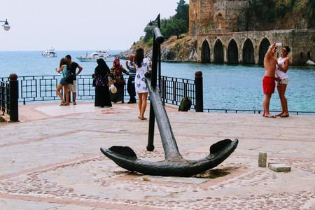 ship anchor: Old anchor on the observation deck in the city harbor (Antalya, Turkey).