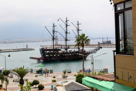 Sailing ships for sea excursions in the city harbor (Antalya, Turkey).