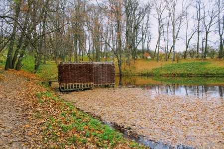 A bath woven from a willow twig on the estate of Leo Tolstoy in Yasnaya Polyana and a small pond.