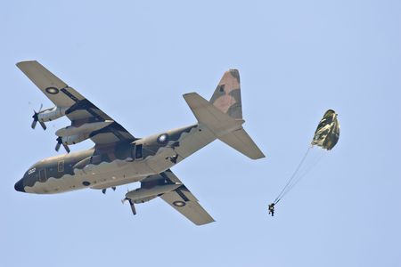 parachuting: Airborne troops parachuting from C-130 transport aircraft