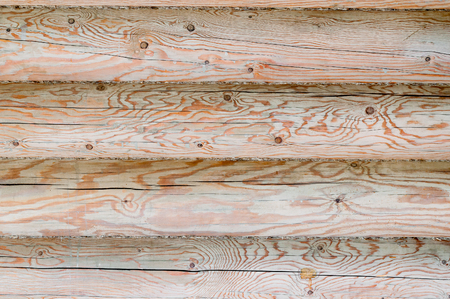 calibrated: Rustic wooden wall from round logs background