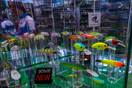 Moscow, Russia - February 25, 2017: Stand with samples of the newest fishing lures and wobblers on special exhibition