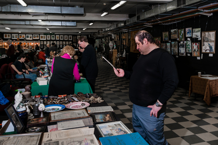 Moscow, Russia - March 19, 2017: Showroom is a covered antique market with a lot of rare antiques, collectibles items and art Editorial