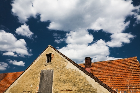 tangible: Old roof on a blue cloudy Sky