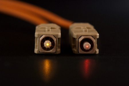 optical fiber: Glowing Fiber Channel SC Connectors on Isolated Black Image Stock Photo