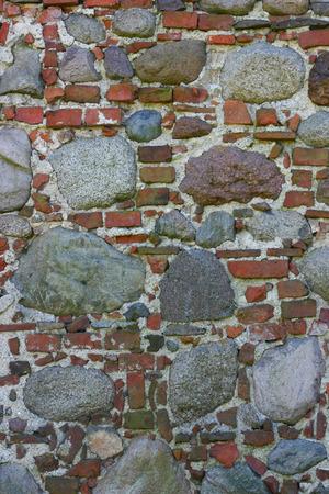 disintegrate: Wall made of bricks and rocks