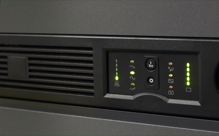 Closeup of an uninterruptable power supply (UPS) in black with selective focus photo