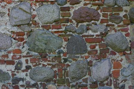 disintegrate: Old wall made of bricks and rocks