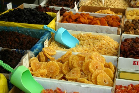 diarrhoea: Boxes with different kinds of dry fruits on a marketplace.
