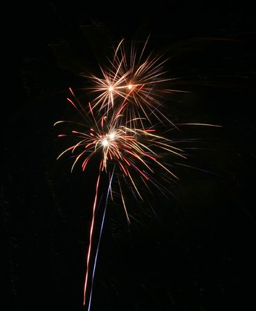 Four simultanious fire work explosions and lots of copyspace photo