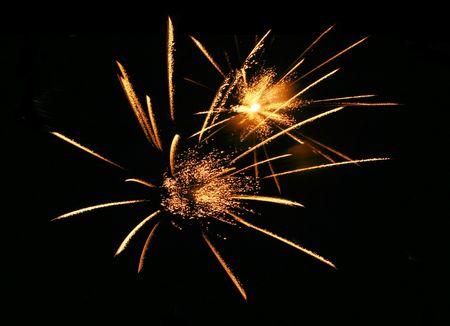 Golden firework explosions photo