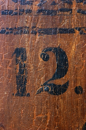 pew: Grungy number 12 on an old church pew (more numbers are coming)
