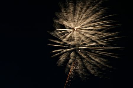 Firework explosions blown away by the wind (motion blur) photo