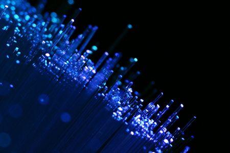 fiber optics: Fiber optics background with lots of blue light spots