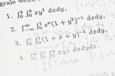 Mathematical background with typed integrals and scribbled down solutions photo
