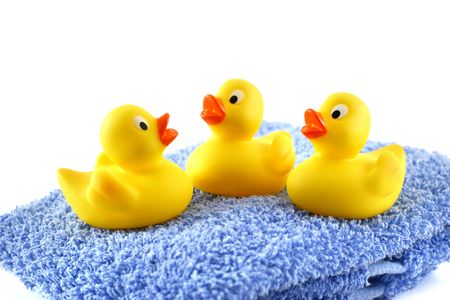 squeaky clean: Three rubber ducks on a blue towel