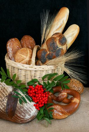 Basket filled with german bread and rolls photo