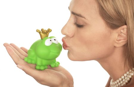 Frog price being kissed by a beautiful glamour model isolated on white Stock Photo
