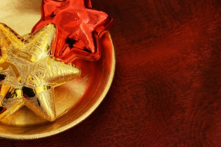 Golden and red stars on a golden plate Stock Photo - 3852155