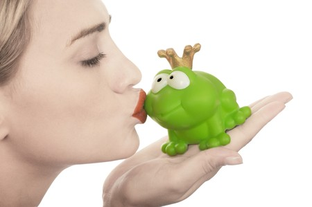 red frog: Frog price being kissed by a beautiful glamour model with pale skin isolated on white