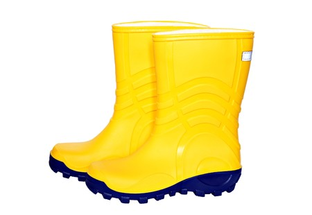 wade: Pair of yellow rubber boots isolated on white