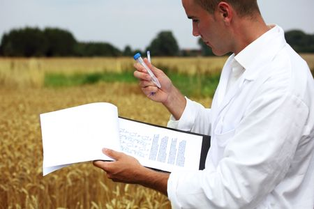 raiser: Scientist in the field collecting sample for analysis Stock Photo