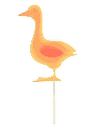 Caramel candy on a stick in the form of goose. Delicious sweet snack for kids.