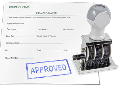 Isolated white background loan application approved rubber stamp for office supply. Stock Photo