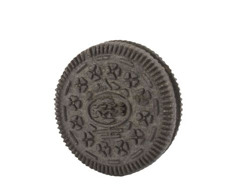 Isolated black chocolate brown cookies with white background.