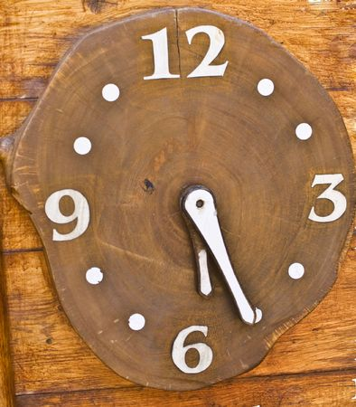 Wooden clock with white arrow and number exotic rustic watch time.