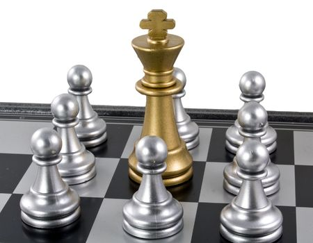 Gold king with silver pawn in the chess board ready to fight. Stock Photo