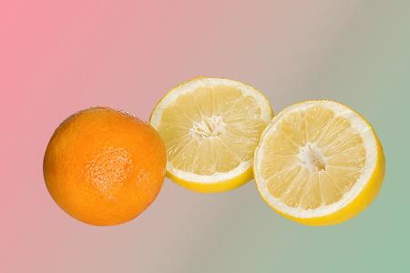 orange and lemon sliced on a gradient background