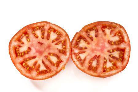 tomato slices: tomato slices on a white background