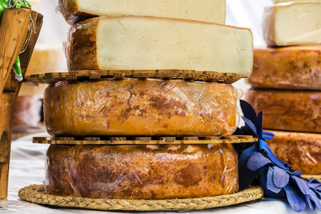 fateful: hand made cheeses stacked on wood exposed