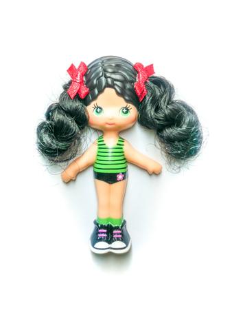 enfant maillot de bain: a girl doll in swimsuit summer