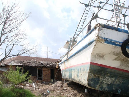 st bernard: Shrimp Boat into home in St Bernard Parish, LA Stock Photo