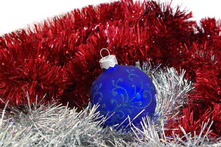 Blue christmas ball and silver tinsel