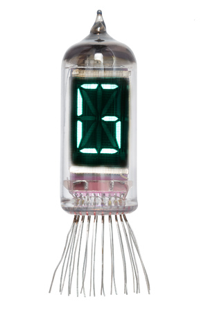 The real Nixie tube indicator of the alphabet of retro style, isolated on white background. Display with green backlight. Letter G.