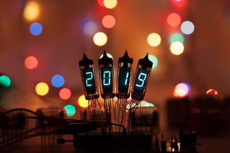 Happy new year is written with a lamp light. Radio electronic lamps. 2019. Original designed congratulation with a beautiful bokeh