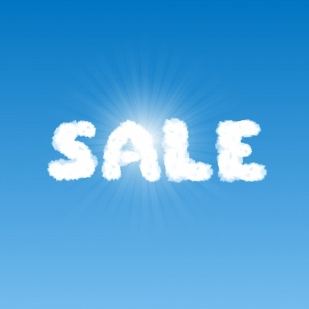Word Sale shape clouds in blue sky with bright sun behind it