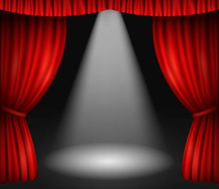 Theater stage with red curtains and spotlight