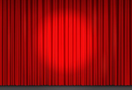 Red velvet curtain in theater with spot of light