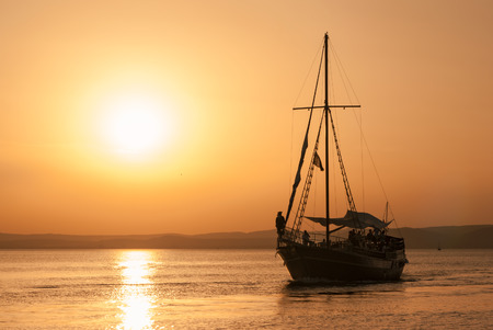 sunup: Boat on sunset Stock Photo