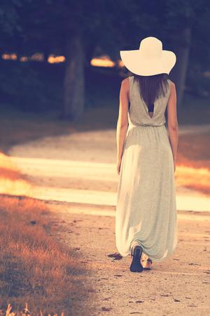 woman standing back: Walking lady Stock Photo